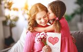 Happy Mothers Day! Child Daughter   Gives Mother A Bouquet Of Flowers And Postcard. poster