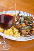 foto of rutabaga  - Barbecued quails served with roasted rutabaga and a glass of Pinot Noir - JPG