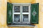 picture of engadine  - Detail of a typical window with decorations in Zuoz Engadine Switzerland - JPG