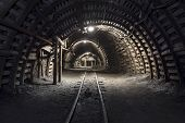 stock photo of dungeon  - Illuminated Underground Tunnel in the Coal Mine - JPG