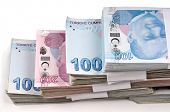 stock photo of turkish lira  - Bunch of Turkish Lira over white background - JPG