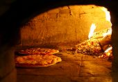 picture of oven  - Pizzas baking in an open firewood oven - JPG
