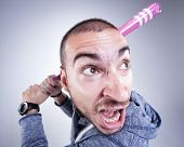 stock photo of hooligan  - funny hooligan with a pink baseball bat screaming in the studio - JPG