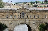 stock photo of rebuilt  - Originally built in the 1700s the Pulteney Bridge was damaged and rebuilt - JPG