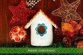 foto of nesting box  - Nesting box and Christmas decorations on wooden background - JPG