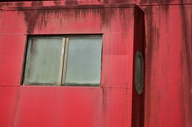 image of caboose  - Close up of windows in an old red train caboose - JPG