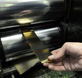 foto of wallow  - Post processing of golden plate in jewelry production facility - JPG