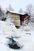 picture of water-mill  - Old frozen water mill near icy water snowy winter scenery - JPG