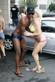 HOLLYWOOD - AUGUST 25: Jerron and Emma at the Adam Carolla and 97.1 KLSX Free FM Charity Car Wash to