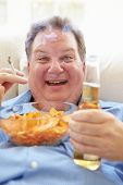 foto of obese man  - Overweight Man Eating Chips - JPG