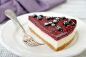 picture of cheesecake  - Black currant cheesecake with fresh berries on plate closeup - JPG