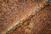 foto of scrap-iron  - background or texture the weld on the scrap iron - JPG