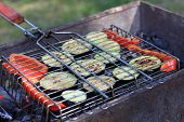 pic of marrow  - Slices of vegetable marrow and pepper on barbecue grill at picnic - JPG