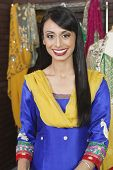 image of dupatta  - Portrait of an attractive Indian female dressmaker smiling - JPG
