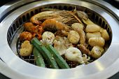foto of korean  - Food on Korean BBQ grill  - JPG