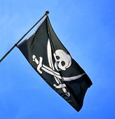 image of crossed swords  - A skull and cross swords flag flying - JPG