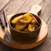 stock photo of plantain  - Fried slices of the ripe plantain in bowl which can be eaten as snack or is used to accompany dishes in some South American countries  - JPG