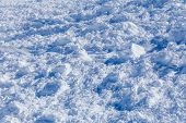 foto of avalanche  - Close up of snow clods on the track of the avalanche in the mountains - JPG