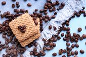 picture of shortbread  - Shortbread cookies with spilled coffee beans on blue wooden background with jeans material - JPG