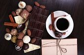 picture of chocolate spoon  - A Cup of coffee and a saucer with chocolate spoon and cute present - JPG