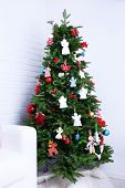 image of christmas angel  - Knitted Christmas angels and other decorations on Christmas tree background - JPG