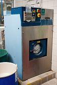 picture of oversize load  - Industrial blue washing machines in a laundromat - JPG