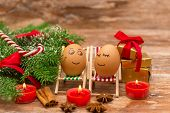 stock photo of view from space needle  - funny eggs on a beach chairs - JPG