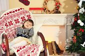 pic of chimney rock  - Little girl sitting in rocking chair near fireplace  - JPG