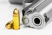foto of arsenal  - Bullets with the gun isolated on the white background - JPG