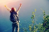 picture of open arms  - cheering woman hiker open arms at mountain peak - JPG