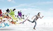 picture of running-late  - Young woman in casual running in a hurry - JPG