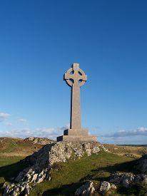 stock photo of celtic  - A Celtic cross on Llandwyn island in the Menai straits  - JPG