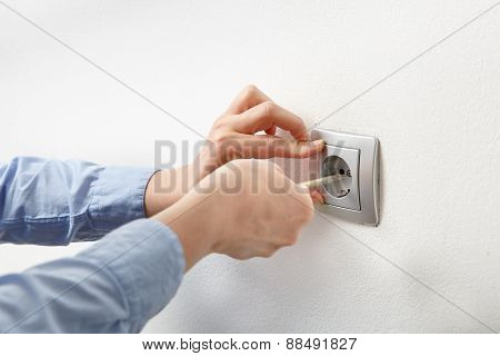 Electrician Installing Ac Power Socket