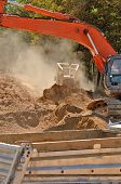image of track-hoe  - Large bulldozer and track hoe excavator moving rock and soil for fill for a new commercial development road construction project - JPG