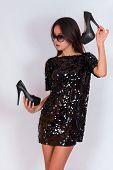 pic of little black dress  - Beautiful brunette girl in a black dress and glasses - JPG