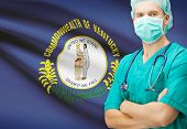 pic of surgeons  - Surgeon with US state flag on background  - JPG