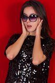 foto of little black dress  - Beautiful brunette girl in a black dress and glasses - JPG
