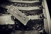 image of old suitcase  - Not the color image of two old suitcases on railway rails - JPG