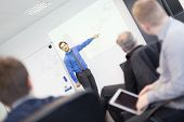 picture of employee  - Business man making a presentation at office - JPG