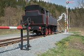 stock photo of locomotive  - The old steam locomotive is parked on track - JPG