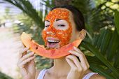 pic of facial  - Beautiful caucasian woman having fresh fruit papaya natural facial mask apply antioxidant skin care and wellness - JPG
