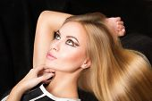 foto of charming  - Charming young woman with beautiful blonde hair lying - JPG