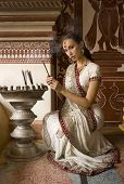 pic of sari  - Beautiful young indian woman in traditional clothing with incense bridal makeup and oriental jewelry - JPG