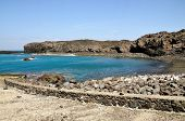 picture of arid  - The bay of Salinas in the town of Sao Jorge on the island of Fogo Part of Republic of Cabo Verde with its dry arid aroma during a sunny afternoon - JPG