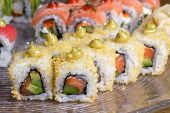 stock photo of sushi  - Tempura prawn sushi. Close-up of green sushi with avocado and tempura shrimps