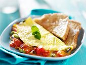stock photo of breakfast  - breakfast  omelet with buttered toast - JPG