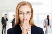 stock photo of gesture  - Beautiful business woman gesturing silent - JPG