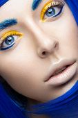 foto of wig  - Beautiful girl in a bright blue wig in the style of cosplay and creative makeup - JPG