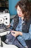 foto of sewing  - Industrial sewing machines sewing machine operator with chain - JPG