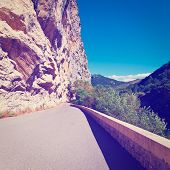 picture of french curves  - Winding Asphalt Road in the French Alps Instagram Effect - JPG